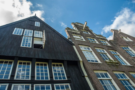Amsterdam typical houses fronts under a clody sky, Netherlands