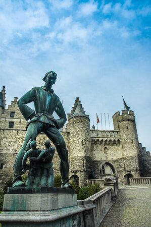 The statue of the mythical giant, Lange Wapper, outside the Het Steen or Stone Castle, in Antwerp, Belgium