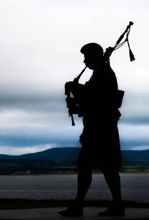 bagpipe: Bagpiper playing music in a festival