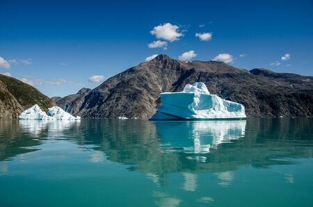 Small icebergs and reflections near the coast, Greenland