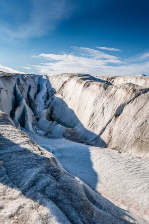 Fissure in top surface of a glacier, Svalbard Stock Photo