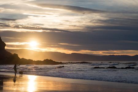 girls at the beach series: Sopelana beach at dusk, in Basque Country
