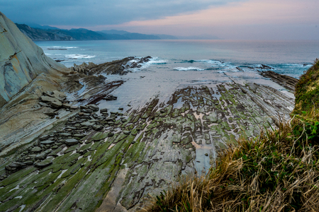 Zumaia flysch coast at sunset, Basque Country