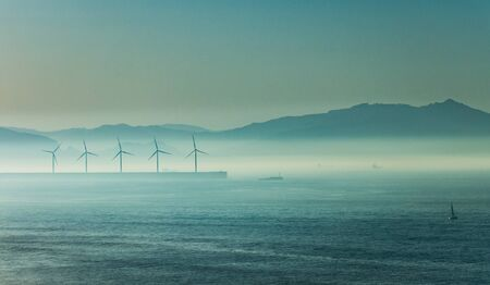 basque country: Windmill under the sea mist at dusk, Basque Country Stock Photo