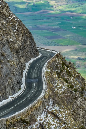 Left curve in the road of a mountains port, Basque Country 스톡 콘텐츠