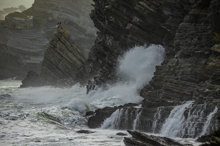 Sea waves breaking in the coast cliffs in Barrika, Basque Country Stock Photo