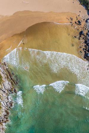 surfer in Sonabia beach in Cantabrian sea, Spain - drone aerial 3 Stock Photo
