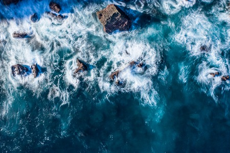 Blur of sea waves colors breaking in the coast of Lekeitio, Basque country - drone aerial view, long exposure