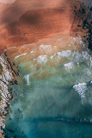 Surfer in Sonabia beach in Cantabrian sea, Spain - drone aerial 2