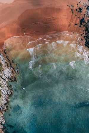 Surfer in Sonabia beach in Cantabrian sea, Spain - drone aerial