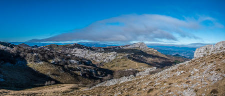 Trail path view from Gorbea hillside, Basque Country - 21:9 panoramic