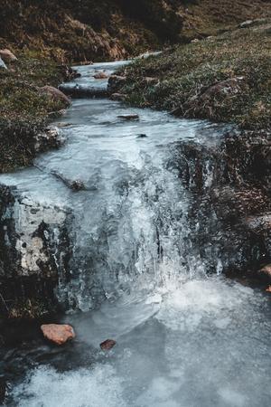 Frozen creek in Gorbea mountain in winter, Basque Country
