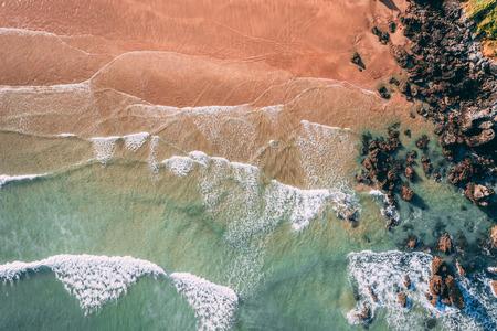 Waves in Sonabia beach in Cantabrian sea, Spain - drone aerial Reklamní fotografie
