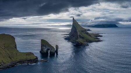 Drangarnir, Tindholmur and Mykines islands drone aereal view from Vagar, Faroe Islands 16:9 Stockfoto