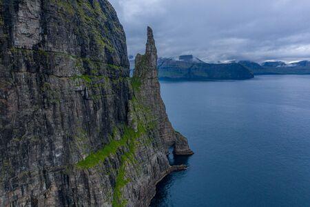 Aerial view of Trollkonufingur, Witchs Finger, Fjord under the clouds on Vagar island, Faroe Islands Reklamní fotografie