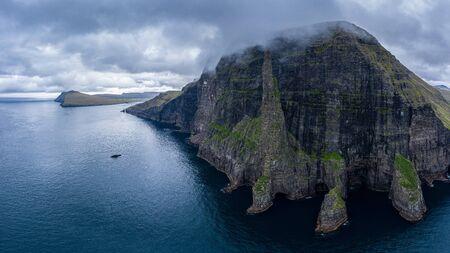 Aerial view of Trollkonufingur (Witchs Finger) Fjord under the clouds on Vagar island, Faroe Islands Reklamní fotografie