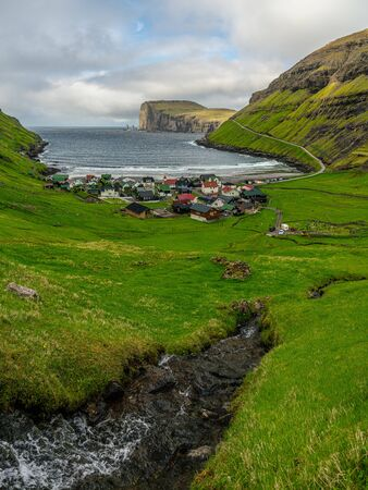 Tjornuvik village and beach with The Giant and the Witch sea stacks rocks, Faroe Islands