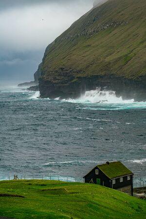 Brave sea near natural harbour gorge in Gjogv village, Faroe islands Reklamní fotografie