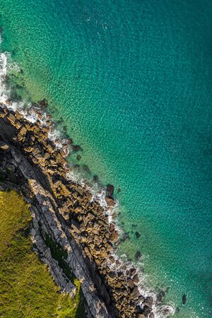 Sea waves breaking in the reefs and coast, Cantabrian sea, Spain - drone aerial view