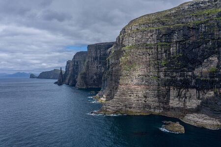 Panoramic aerial view from Sandoy island cliffs and rock stacks under the clouds, Faroe Islands Reklamní fotografie