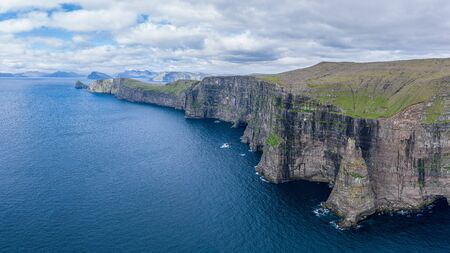 Panoramic aerial view from Sandoy island cliffs under the clouds, Faroe Islands