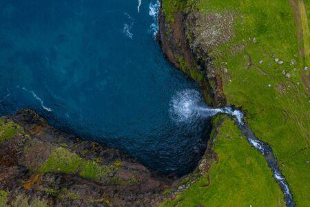 Mulafossur waterfall aerial drone view in Gasadalur, Vagar, Faroe Islands