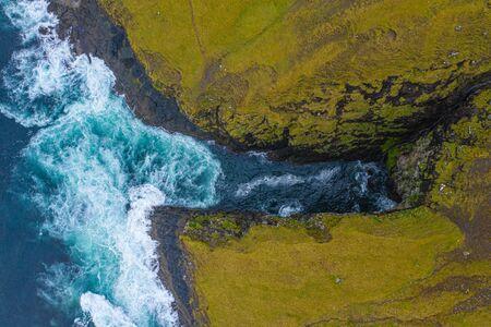 Atlantic ocean sea waves in Bordoy cliffs, Faroe Islands