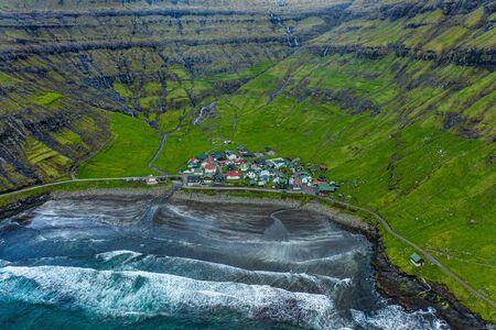 Tjornuvik village and beach and waterfalls aerial view, Faroe Islands Reklamní fotografie