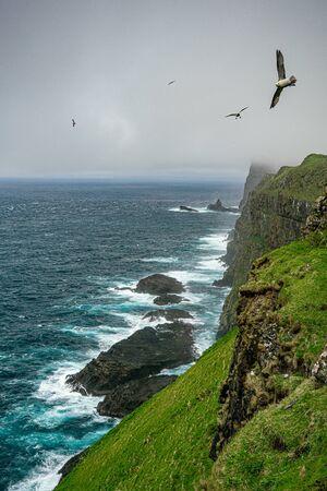 Sea waves breaking in Mykines island cliffs, Faroe Islands Reklamní fotografie