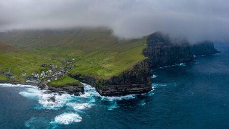 Natural harbour gorge in Gjogv village aerial view, Faroe islands Reklamní fotografie