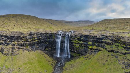 Aerial view of Fossa top side of double-tiered waterfall, Faroe Islands 16:9 Фото со стока