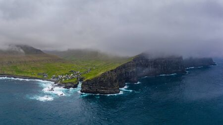 Natural harbour gorge in Gjogv village aerial view, Faroe islands 16:9 Фото со стока