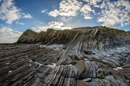 Detail of the coast cliffs in Zumaia, Basque Country Фото со стока