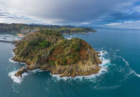 Getaria lighthouse in Gipuzkoa, Basque country - drone aerial view