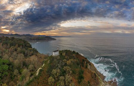Getaria lighthouse at dusk, Basque country - drone aerial view Standard-Bild