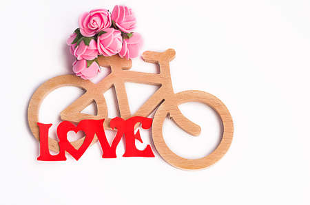 Toy bicycle made of thin hands carved wood Stock Photo