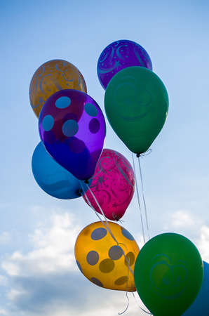 permitting: Painted balloons against the sky in summer weather permitting Stock Photo