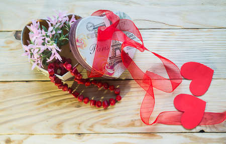 old styled: Box in the form of heart for storage of jewelry on a wooden background Stock Photo
