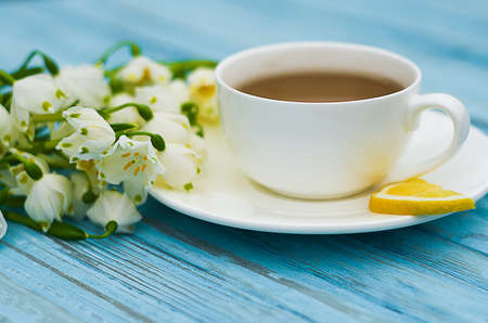 Spring breakfast hot tea and a bouquet of snowdrops for a good mood Stock Photo