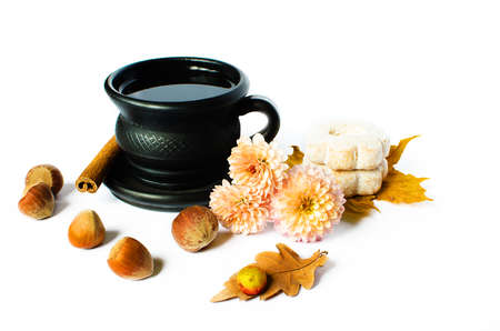 Hot tea in a pot on a limited white background with cookies and decorations