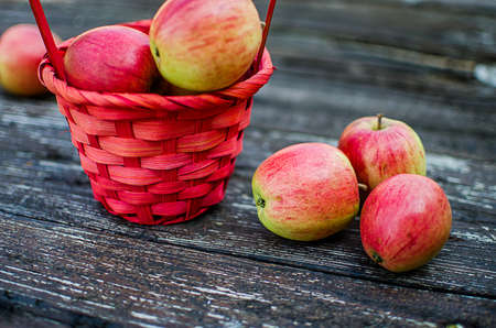 Apples on a limited background in the basket and juice