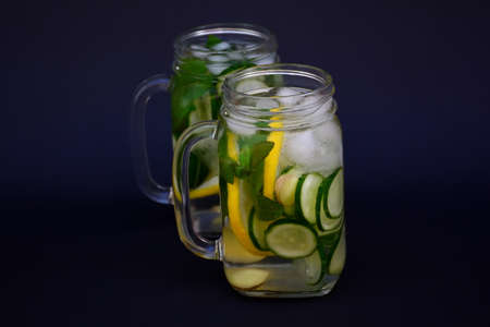 Refreshing drink of cucumber, lemon and ginger Stock Photo