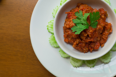 flay: very famous Thai Northern Style paste dip called Nam Prik Ong. spicy and yummy minced Pork with Tomato Relish and hot chilli pepper paste sauce. together with vegetable like cucumber.