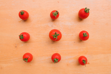 lycopene: Cherry Tomato fresh group on wooden chopping board. Flat lay, top view