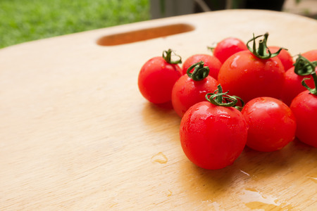lycopene: Cherry Tomato fresh group on wooden chopping board. Stock Photo