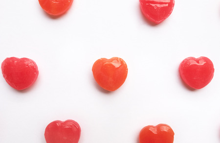 Red Valentines day heart shape candy pattern on empty white paper background. Love Concept. colorful hipster style. Knolling top view. Stock Photo