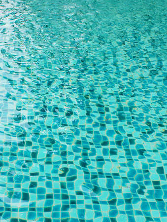 ripple effect: Background of rippled pattern of clean water in blue swimming pool                      Stock Photo