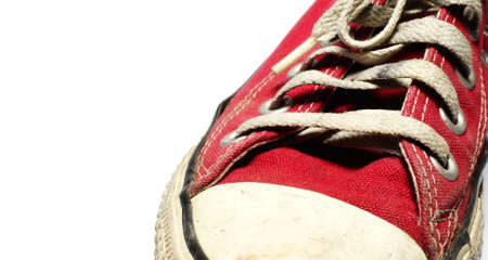A pair of old sneakers, isolated on white background                photo