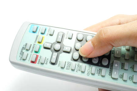 remote control in hand isolated on white background         photo