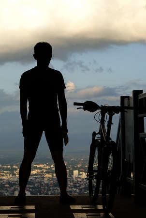 Silhouette of a man on muontain-bike Stock Photo - 10325137